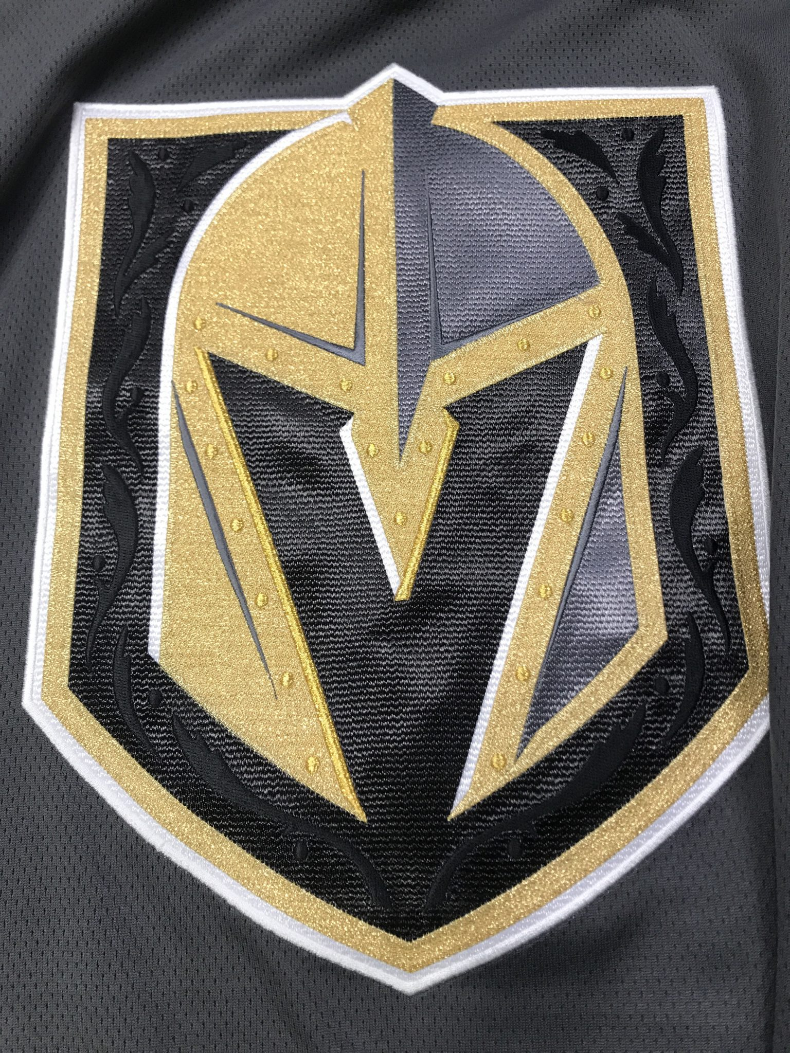 a868d8c1 On to my favorite part of the jersey, the intricate design inside of the  Vegas Golden Knights primary logo. Both jerseys have the rivets around the  V and ...